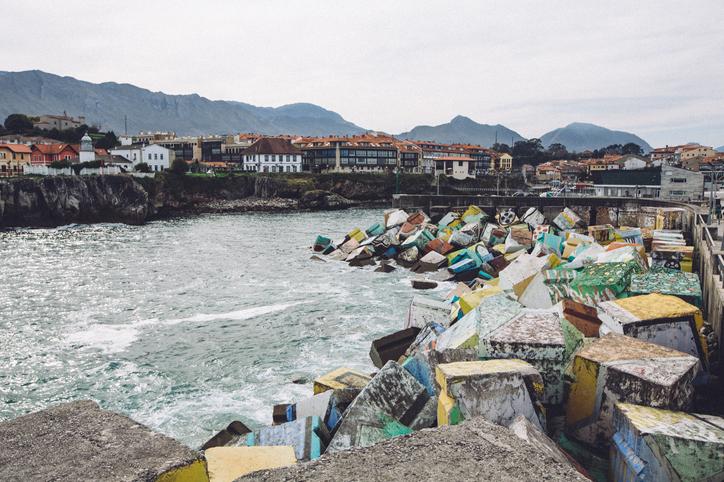 Llanes harbor painted concrete blocks on atlantic coast of Spain
