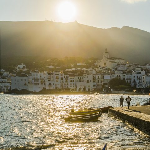 Cadaqués in the Costa Brava (Catalonia) under golden rays of sun in the evening on summertime